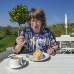 Shirley enjoying her large slice of coconut cake (and coffee)