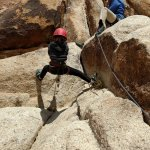 Kelly, our guide, coaches our daughter through rappelling down.