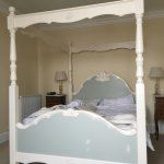 Our cosy four-poster bed