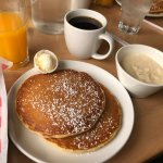 Side of pancakes, cheesy grits and fresh squeezed OJ