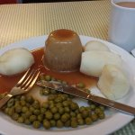 An honest plate of food - steak and kidney pudding, peas and mash and a lovely mug of tea.
