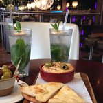 Hummus with flat bread, olives, and English Mojitos
