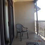 This is the balcony it has two chairs and table