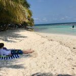 My son on Pumpkin Caye watching conch fisherman