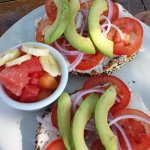 Everything bagel with cream cheese, tomatoes, onions and avocado