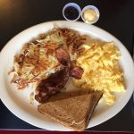 3 Egg Breakfast Platter with bacon, wheat toast, and hashbrowns