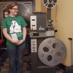 Antique projector with Atlanta Film Festival volunteer for scale