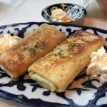 Blini -Thin crepe like pancakes stuffed with seasoned ground beef filling, served with sour crea