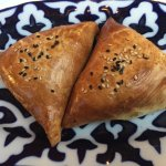 Samsa - Thinly rolled butter dough stuffed with seasoned dices of lamb, onions and spices
