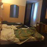 More like a motel, very close to highway,easy exit to it. Receptionist Ivan-great! Speaks 4 fore