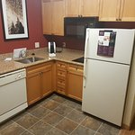 kitchenette with dish washer, refrigerator, freezer, stove, microwave etc.