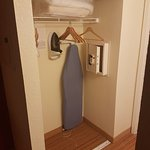 Closet with ironing board and safe