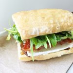 Brie, bacon, onion jam, and arugula sandwich