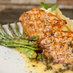 Charbroiled salmon fillet top with our homemade style passion fruit sauce. A must try!!!!