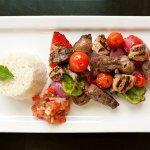 Espetinho misto with your options of chicken of beef skewers  or only veggies.