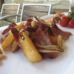 "Feeling adventurous try our "" Linguica frita with Yucca"""