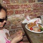 Myra enjoying her shrimp.
