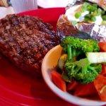 Ribeye steak, veggies and loaded baked potato