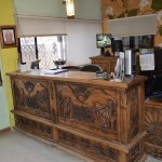 Front desk. The place has beautifully carved wood furniture and doors.