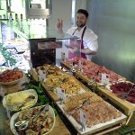 Cold meats and cold seafood and sushi display counter