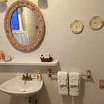 Clean and artfully decorated bathroom.
