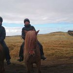 My wife and I enjoying the famous Icelandic horses.