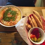 Qudsiah Hummus Plate ($9.50) with pita, olives and pickles