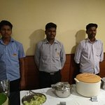 Udhayan is at the centre (flanked by his team) who spearheads the catering team in dining hall.