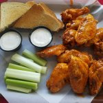 Hot wings with Texas toast, celery and ranch. Dawn's secret hot wing sauce