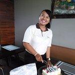 Birthday girl cutting her cake .