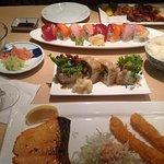 Late night cravings... — eating sushi.