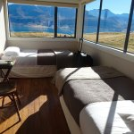 Room with a view! Enclosed porch with four twin beds.