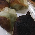 Undercooked pork fried dumplings & burnt vegetarian dumplings