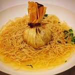 Chicken wonton and noodles in truffle consumme