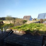 Solar panels, green roof and part of the garden