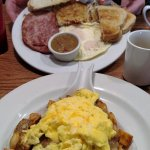 Skillet with scrambled eggs and green chili....ham steak and eggs. Coffee!