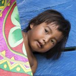 Young Embera girl hiding behind her mom