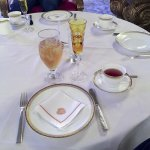 table setting with hot and iced tea for me and a flute of champagne