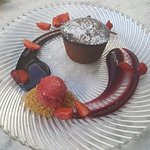 Tortino Al Cioccolato Colante- Chocolate fondant, strawberry sorbet, berry coulis