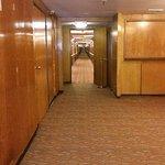Empty hallway with original paneling