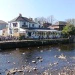 View of pub  from pedestrian bridge, nice terrace  by riverside