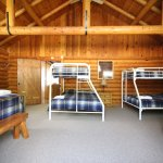 The Cedars log home with 15 beds throughout the five bedrooms and sleeping loft