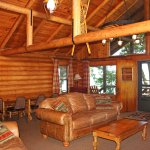 The Cedars log home great room with dining area for 16+ guests