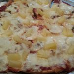Gluten free pizza crust with mushroom and pineapple