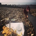 Freshly cooked battered cod and haddock with chips :) Enjoyed by the coast less than 2 mins walk