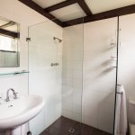 River cottage bathrooms have shower, toilet and sink.