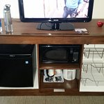TV stand, microwave, fridge, & storage