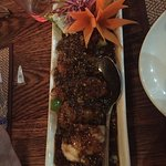 Daily fish topped with honey ginger garlic chili sauce