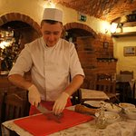 A friendly young chef making the Polish beef tartar in front of me.