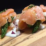 Our newest appetizer- Fresh asparagus wrapped in smoked salmon & Boursin cheese.  Delicious!